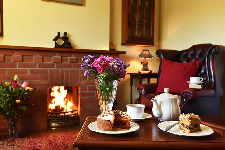 Tea and cakes by the fire